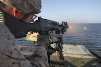 A Marine with Battalion Landing Team, 1st Battalion, 6th Marine Regiment, 22nd Marine Expeditionary Unit fires on a floating target during a live fire range aboard the amphibious dock landing ship USS Whidbey Island (LSD 41), Nov. 20, 2016. 22nd MEU, deployed with the Wasp Amphibious Ready Group, is maintaining regional security in the U.S. 5th Fleet area of operations.