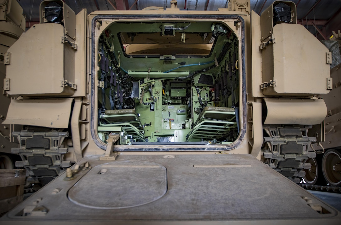 A Bradley Fighting Vehicle is prepositioned inside a warehouse maintained by the 401st Army Field Support Brigade on Oct. 21, 2016 at Camp Arifjan, Kuwait. This vehicle is part of the thousands of prepositioned, combat-ready equipment and material at Camp Arifjan to support unified-land operations all over the U.S. Central Command area of operations. (U.S. Army photo by Sgt. Angela Lorden)