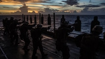 "Marines with the Maritime Raid Force, 11th Marine Expeditionary Unit, conduct combat marksmanship and close-quarters tactics training during a ""deck shoot"" aboard the USS Makin Island (LHD 8), while afloat in the Pacific Ocean, Nov. 2, 2016. As one of the MEU's maneuver elements, the MRF's main specialties consist of Visit, Board, Search, and Seizure missions conducted on opposed vessels while at sea, and limited-scale ground raids."