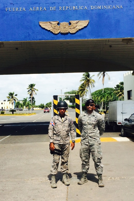 U.S. Air Force Staff Sgt. Angel Moquete, assigned to the 571st Mobility Support Advisory Squadron based at Travis Air Force Base, Calif., right, poses for a photo with a host-nation security force member in the Dominican Republic, Nov. 15, 2016. Air Force photo by Staff Sgt. Robert Hicks