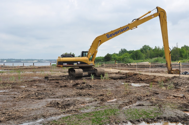 Heavy equipment near the banks of the Raritan River in Sayreville, NJ, removes contaminated soil from marsh land 30 miles southwest of Manhattan. The six-acre Superfund site, being remediated by the U.S. Army Corps of Engineers, New York District, is expected to be free of contaminants in 2017. (Photo: James D'Ambrosio, Public Affairs Specialist, U.S. Army Corps of Engineers, NY District.)