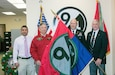 (Left to right) 94th Training Division Chief Executive Officer Vivek Kshetrapal, 94th Infantry Division Historical Society Secretary John Clyburn, 94th Training Division Assistant Division Commander Col. John Aarsen, and 94th IDHS Immediate Past President Bill Van Sant participate in the flag transfer held at Fort Lee, Virginia, Nov. 21, 2016. The 94th IDHS passed their World War II colors to the current 94th Training Division at the division's headquarters.