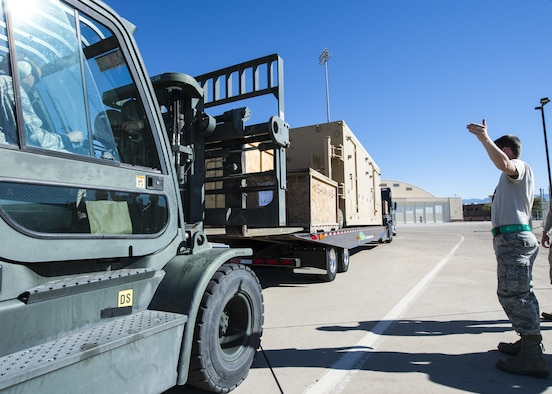 Staff Sgt. Paul, a 49th Aircraft Maintenance Squadron aircraft communications maintenance technician, guides a forklift to unload a new Ground Control Station from a delivery truck Nov. 14 at Holloman Air Force Base, N.M. All GCSs at Holloman are scheduled to be replaced by early 2018 as part of an Air Force-wide initiative to upgrade current Remotely Piloted Aircraft mission systems. (U.S. Air Force photo by Senior Airman Emily Kenney)