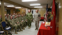 FORWARD OPERATING BASE UNION III, Iraq - Brig. Gen. Rick A. Uribe, Deputy Commanding General-Baghdad of Combined Joint Forces Land Component Command – Operation INHERENT RESOLVE, right, and Australian BRIG Roger Noble, the Guest of Honor, left, participate in a cake cutting ceremony for the Marine Corps' 241st birthday at Forward Operating Base Union III, Baghdad, Iraq, November 10, 2016.