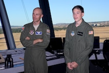 Mark Carnes, the U.S. Air Force Academy's latest Cadet for a Day, and Capt. Daniel Norton, look out the control tower windows at the Academy airfield, Nov. 10, 2016. The Academy has teamed up with the Make a Wish Foundation to help children with serious medical conditions achieve their dreams of becoming an Academy cadet, through the Cadet for a Day Program. Norton is the flight commander for the Cadet Instructor Pilot Upgrade Program for the 94th Flying Training Squadron. (U.S. Air Force photo/Darcie Ibidapo)