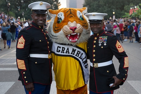 Sergeant Major Anthony N. Page, sergeant major of the 6th Marine Corps District, and Sgt. Maj. Samuel Heyward Jr., sergeant major of the Marine Corps Recruiting Command, pose in a photo with the Grambling State University mascot during the Bayou Classic Thanksgiving Parade Nov. 24, 2016. The Bayou Classic is the annual series of fan events and leading up to the rivalry football game between Southern University and Grambling State University held the week of Thanksgiving. (Photo by. John-Paul Imbody/Released)