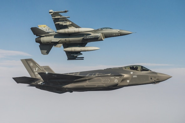 An F-35A Lightning II flies alongside an F-16 Fighting Falcon June 25, 2015, at Luke Air Force Base, Ariz. In October, F-35 and F-16 pilots began integrated training designed to improve mission cooperation and flight skills in both airframes. (Courtesy Photo)