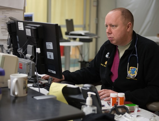 Maj. (Dr.) Paul Butts, 81st Medical Operations Squadron physician, updates patient records in the emergency services department at the Keesler Medical Center July 1, 2016, on Keesler Air Force Base, Miss. Keesler's emergency room, which is open 24/7, sees around 2,000 patients monthly and is one of several clinics in the medical center. (U.S. Air Force photo by Marie Floyd/Released)
