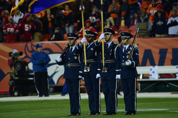 Mile High Honor Guard presents the colors during a Denver Broncos Salute to Service pregame ceremony Nov. 27, 2016, at Sports Authority Field at Mile High in Denver. The Salute to Service game was comprised of pregame and halftime ceremonies that honored service members, including all military branches, Denver police officers and firefighters. (U.S. Air Force photo by Airman 1st Class Gabrielle Spradling/Released)