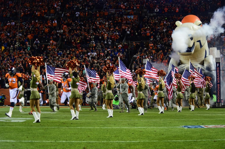 Service members participate in a Denver Broncos Salute to Service pregame ceremony Nov. 27, 2016, at Sports Authority Field at Mile High in Denver. The pregame ceremony allowed service members in the Colorado National Guard to run onto the field before and with the Broncos players. (U.S. Air Force photo by Airman 1st Class Gabrielle Spradling/Released)