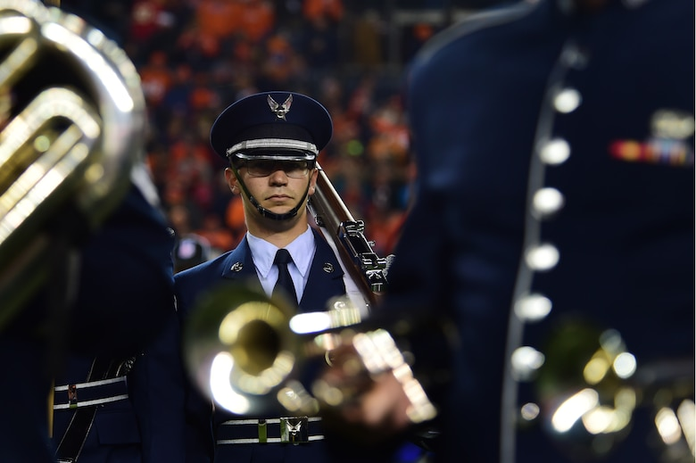 Airman 1st Class Paul Lombardi, 566th Intelligence Squadron signals intelligence analyst, participates in a Denver Broncos Salute to Service pregame ceremony Nov. 27, 2016, at Sports Authority Field at Mile High in Denver. Service members took part in both the pregame and halftime ceremonies as part of the Salute to Service program that aims to recognize their dedication. (U.S. Air Force photo by Airman 1st Class Gabrielle Spradling/Released)