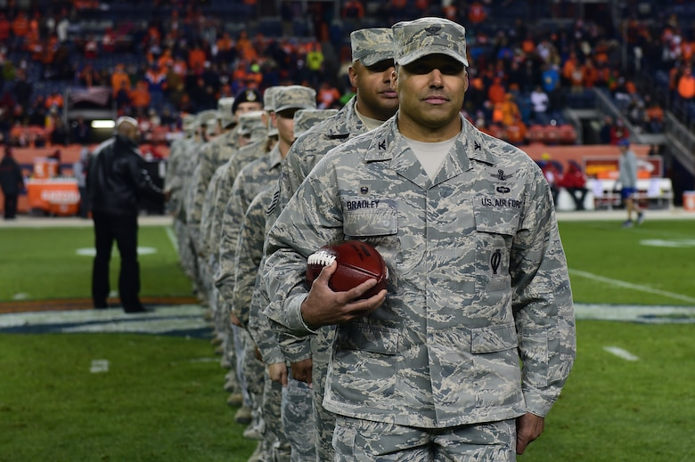 Col. Lorenzo Bradley, 460th Operations Group commander, along with other members of Team Buckley participate in a halftime ceremony Nov. 27, 2016, during a Denver Broncos Salute to Service game at Sports Authority Field at Mile High in Denver. The pregame and halftime ceremonies included representatives from all branches. (U.S. Air Force photo by Airman 1st Class Gabrielle Spradling/Released)