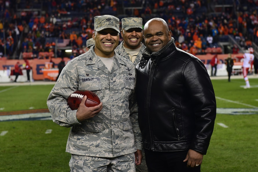 Col. Lorenzo Bradley, 460th Operations Group commander, accepts Salute to Service football on behalf of Team Buckley Nov. 27, 2016, during a Denver Broncos Salute to Service halftime ceremony at Sports Authority Field at Mile High in Denver. The Broncos have participated in multiple Salute to Service opportunities this year, including visiting Buckley Air Force Base and inviting service members to both training camp and a game. (U.S. Air Force photo by Airman 1st Class Gabrielle Spradling/Released)