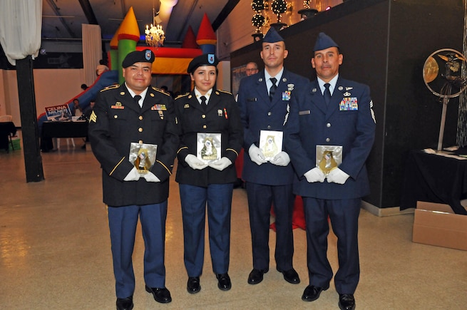 From Left: Army Sgt. Sam Owen, Army Spc. Monica Montoya, Air Force Tech. Sgt. Geiber Rea, and Air Force Chief Master Sgt. John Salazar were presented with awards in recognition of their military service on Oct. 25, 2016 at the League of United Latin American Citizens Utah's Viva America! event in Salt Lake City. (U.S. Air National Guard photo by Staff Sgt. Annie Edwards)