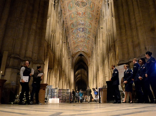 U.S. Air Force Airmen assigned to the 100th Air Refueling Wing await guests attend a Thanksgiving service Nov. 23, 2016, at Ely Cathedral in Ely, England. Volunteers from RAF Mildenhall and RAF Lakenheath helped make the service possible by seating guests, serving refreshments, participating in a joint-base choir and more. (U.S. Air Force photo by Staff Sgt. Kate Thornton)
