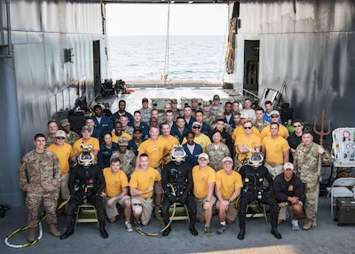 The 511th Engineer Dive Detachment from Fort Eustis, Va., and the entire crew of the MG Charles P. Gross (Logistics Support Vessel-5), pose for a group photo while anchored on the Arabian Gulf, off the coast of Kuwait Naval Base, Nov. 18, 2016. Soldiers from the dive unit utilized the vessel to conduct a two-week diving exercise, Operation Deep Blue, enhancing the team's overall readiness and ability to support U.S. Army Central missions. (U.S. Army photo by Sgt. Angela Lorden)