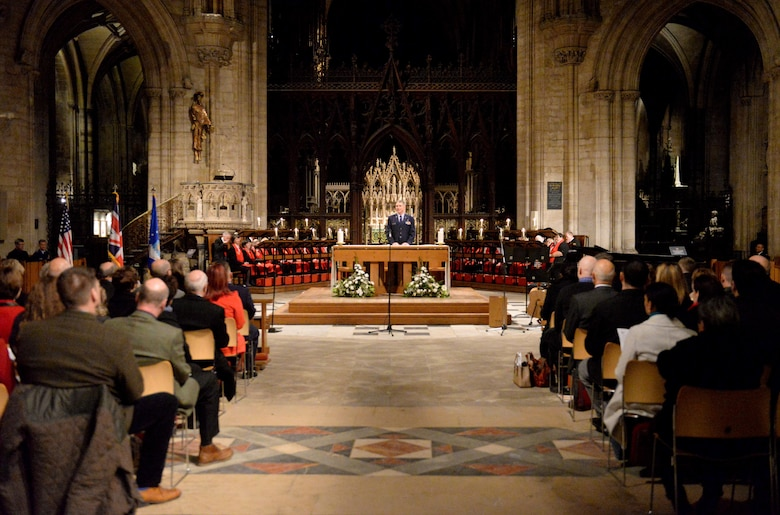 U.S. Air Force Chaplain (Lt. Col.) Timothy Porter, 100th Air Refueling Wing, begins a Thanksgiving service Nov. 23, 2016, at the Ely Cathedral in Ely, England. Although England doesn't celebrate Thanksgiving, Ely Cathedral opens its 900-year-old doors every year to provide U.S. military personnel and local community members a place to celebrate, worship and give thanks. (U.S. Air Force photo by Staff Sgt. Kate Thornton)