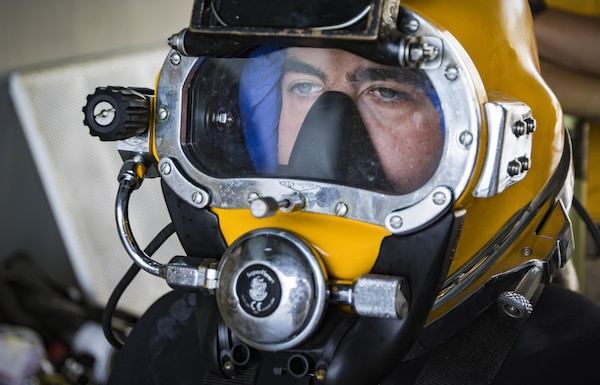 A U.S. Army engineer diver with the 511th Engineer Dive Detachment from Fort Eustis, Va., waits to dive off the MG Charles P. Gross (Logistics Support Vessel-5) and into the Arabian Gulf, off the coast of Kuwait Naval Base, to practice diving procedures Nov. 18, 2016. The unit executed various diving techniques and certified diving supervisors in emergency protocol throughout the exercise, Operation Deep Blue, enhancing the team's overall readiness and ability to support U.S. Army Central missions. (U.S. Army photo by Sgt. Angela Lorden)