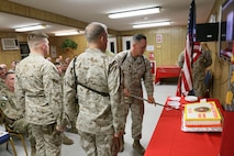 Brigadier General Rick A. Uribe, Deputy Commanding General-Baghdad of Combined Joint Forces Land Component Command – Operation INHERENT RESOLVE, cuts the cake in a cake cutting ceremony for the Marine Corps' 241st birthday at FOB Union III, Baghdad, Iraq, November 10, 2016. Traditionally, a piece of cake will be presented to the Guest of Honor, the oldest Marine present, and the youngest Marine present.