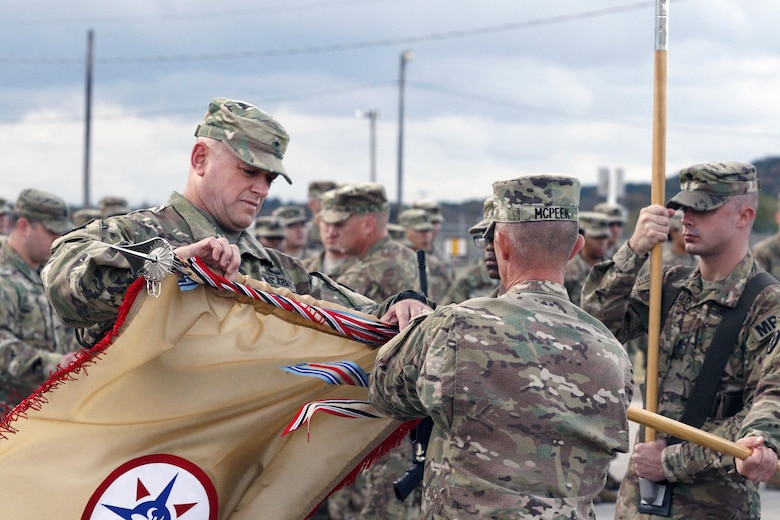 (Left) Brig. Gen. Robert D. Harter, Commanding General of the 316th Sustainment Command (Expeditionary), cases the 316th ESC guidon with Command Sgt. Maj. Johnny McPeek (Right), the 316th ESC Command Sergeant Major, during a Colors Casing ceremony at Fort Hood, Texas Nov. 28, 2016.