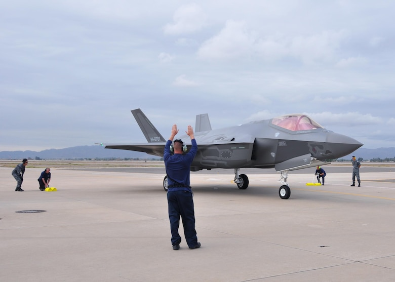 Lockheed Martin and Japanese Air Self-Defense Force personnel work together to taxi in the arrival of the first Foreign Military Sales F-35A onto the 944th Fighter Wing ramp Nov. 28 at Luke Air Force Base, Ariz. The arrival marked the next step for the international F-35 training program. (U.S. Air Force photo by Tech. Sgt. Louis Vega Jr.)