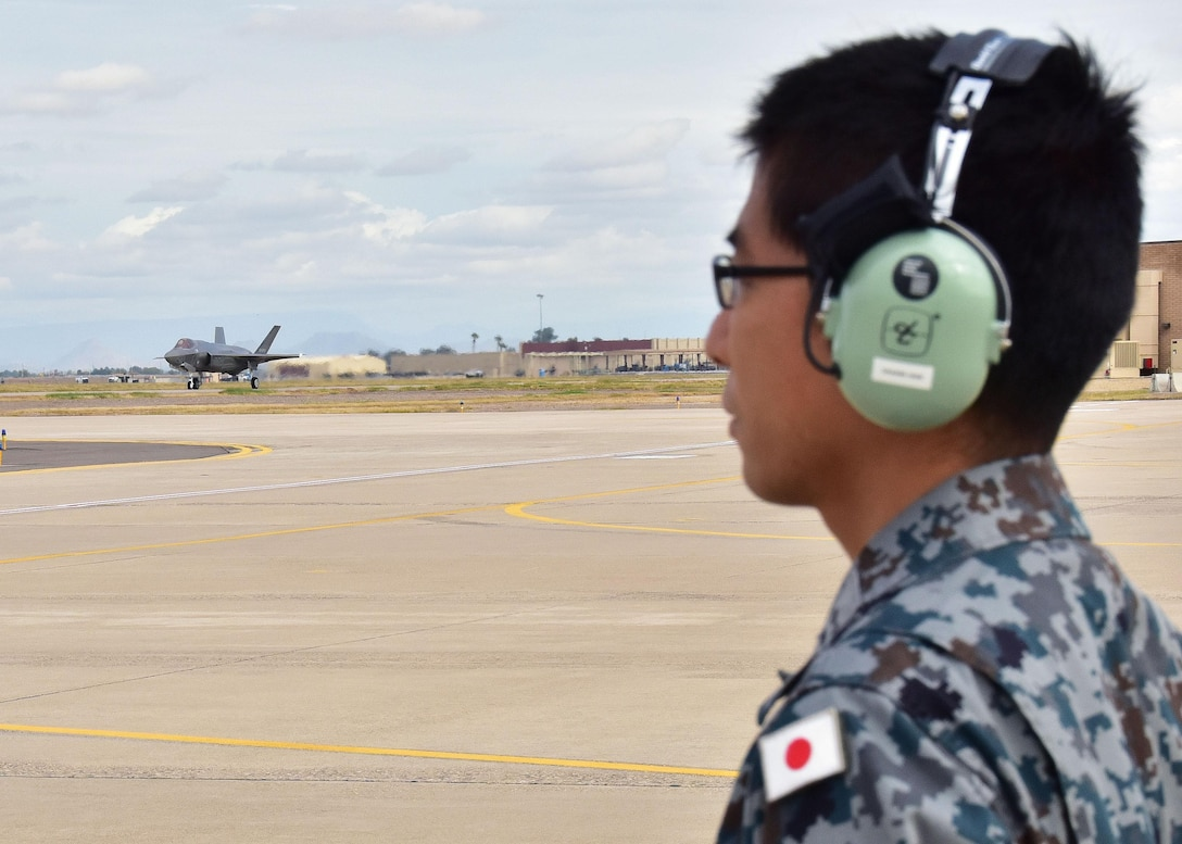 A Japan Air Self-Defense Force maintainer, prepares for the arrival of the first Japanese F-35A Nov. 28 at Luke Air Force Base, Ariz. (U.S. Air Force photo by Tech. Sgt. Louis Vega Jr.)