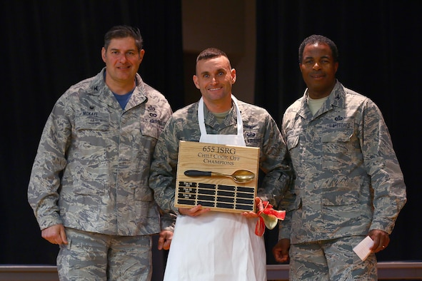 Capt. James Spindler, 64th Intelligence Squadron, is the winner of the 2016 655th Intelligence, Surveillance and Reconnaissance Group Chili Cook-Off at the USO here Nov. 19, 2016. The captain received his apron award from Col. John D. McKaye, 655th ISRG commander (left) and Col. Lonnie Garris, III, 655th ISRG deputy commander. Capt. Spindler's chili won in the 'Best Overall' category. The other three categories judged were: spiciest, white chili and most creative. (U.S. Air Force photo /Tech. Sgt. Patrick O'Reilly)