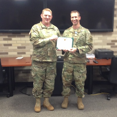In photo (l to r), ERDC Commander Col. Bryan S. Green presents Capt. Joseph Marut III The Army Achievement Medal for outstanding support of a high-level visitor to the ERDC's Cold Regions Research and Engineering Laboratory.