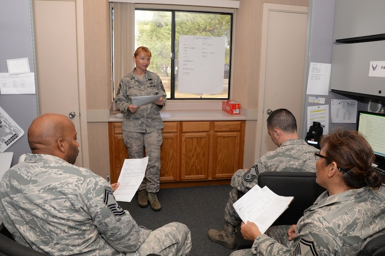U.S. Air Force Senior Master Sgt. Tara Corse, a member of the Air Force Reserve's 48th Aerial Port Squadron, briefs her team about upcoming evaluations at Joint Base Pearl Harbor-Hickam, Hawaii, Nov. 20, 2016. Corse's civilian career as a Regional K-9 training instructor at the Honolulu International Airport and her position in the 48th APS correlate because they are both in the field of airport security and operations. The 48th APS supports the 624th Regional Support Group's mission to deliver mission essential capability through combat readiness, quality management and peacetime deployments in the Pacific area of responsibility. (U.S. Air Force photo by Master Sgt. Theanne Herrmann)