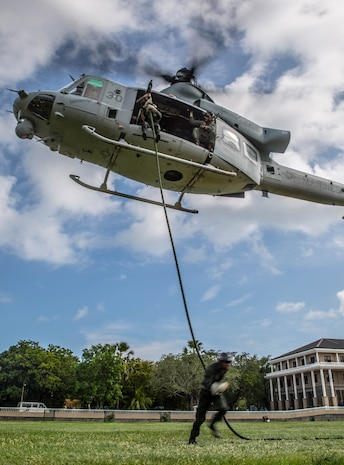 TRINCOMALEE, Sri Lanka (Nov. 23, 2016) Sri Lankan Navy Special Boat Squadron Sailors fast rope out of a UH-1Y Huey helicopter during a Theater Security Cooperation engagement at Sri Lanka Naval Base, Trincomalee, Nov. 23, 2016. The SBS Sailors conducted multiple fast rope repetitions during the training exercise.  The Marines and Sailors of the 11th Marine Expeditionary Unit are conducting the exchange with Sri Lankan forces to enhance tactical skillsets and disaster relief capabilities while strengthening the overall relationship between the two militaries.  (U.S. Marine Corps photo by Gunnery Sgt. Robert B. Brown/Released)