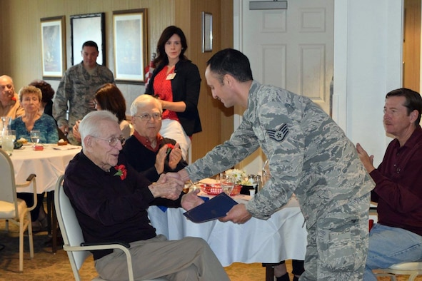 Several members of the 914th Airlift Wing, Air Force Reserve and 107th Attack Wing, Air National Guard, participated in a Veterans Day program at The Elderwood Residences at Wheatfield (NY) November 11, 2016. The Niagara Airmen assisted the staff of Elderwood in presenting certificates of recognition to the veterans living within the community and thanking them for their service. (U.S. Air Force photo by Master Sgt. Kevin Nichols)