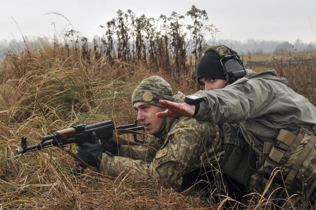 Army Sgt. Christopher Marinucci points to an objective during a training exercise with Ukrainian soldiers at the International Peacekeeping and Security Center in Yavoirv, Ukraine, Nov. 26, 2016. Marinucci is an assistant team leader assigned to the 3rd Infantry Division's 6th Squadron, 8th Cavalry Regiment, 2nd Infantry Brigade Combat Team. The unit's soldiers are training Ukrainian land forces to increase their capacity for self-defense. Army photo by Staff Sgt. Elizabeth Tarr