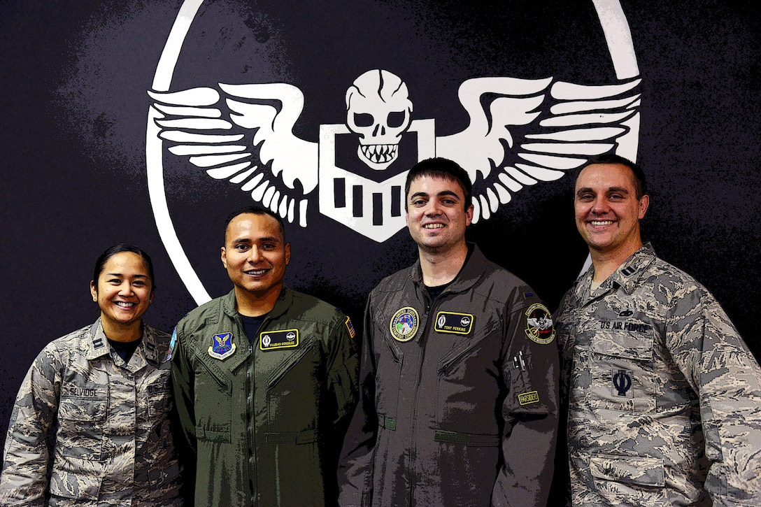 1st Lt. Anthony Perkins, center right, 490th Missile Squadron intercontinental ballistic missile combat crew commander, poses for a photo with his teammates Nov. 4, 2016, at Malmstrom Air Force Base, Mont. Perkins is a missileer, as well as a volunteer firefighter and ambulance emergency medical technician in his off-duty time. (U.S. Air Force photo/Airman 1st Class Magen M. Reeves)