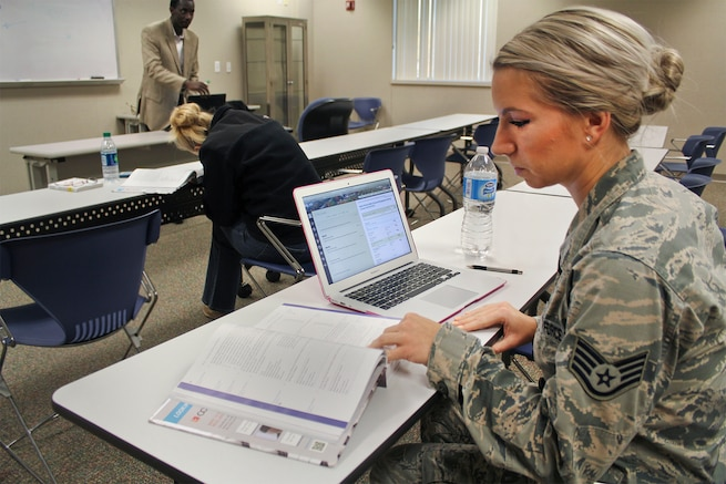Staff Sgt. Kallie Czenkus, an intelligence analyst with the 171st Air Refueling Squadron, prepares for an evening class a Northwood University's satellite campus at Selfridge Air National Guard Base. Czenkus is completing her requirements to earn an associate degree with the Community College of the Air Force. (U.S. Air National Guard photo by Tech. Sgt. Dan Heaton)