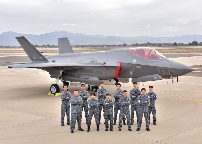 The Japanese Air Self-Defense Force maintainers pose for a photo Nov. 28 during the arrival of the first Japanese F-35A at Luke Air Force Base Ariz. (U.S. Air Force photo by Tech. Sgt. Louis Vega Jr.)
