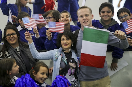 U.S. Marine Corps Lance Cpl. Conor Fredericks, an intelligence analyst with Special Purpose Marine Air-Ground Task Force Crisis Response-Africa, poses for a photo with students and faculty from San Giovanni Bosco Elementary School during a community relations event in Giarre, Italy, Nov. 15, 2016. The Marines and sailors of SPMAGTF-CR-AF spent time with the children teaching classes on nutrition, exercising and taking many group photos to promoting a positive relationship between the United States and Italy. U.S. Marines and Sailors assigned to Special Purpose Marine Air-Ground Task Force-Crisis Response-Africa Command support operations, contingencies and security cooperation in the U.S. Africa Command area of responsibility. (U.S. Marine Corps photo by 1st Lt. Eric Abrams)