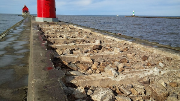Grand Haven south pier construction underway approximately 100 feet of concrete cap has been removed to date, work has been halted for the season due to weather and will resume in the spring. (U.S. Army Photo)