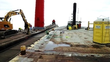 Crews work on removing Grand Haven south pier's concrete cap. Approximately 100 feet of concrete cap has been removed to date, work has been halted for the season due to weather and will resume in the spring. (U.S. Army Photo)
