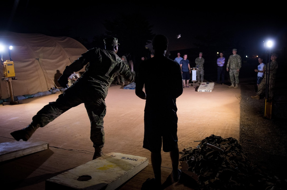 Lt. Gen. Richard Clark, 17th Expeditionary Air Force commander, plays cornhole with Airmen from the 768th Expeditionary Air Base Squadron at Air Base 101, Niamey, Niger, Nov. 22, 2016. During a three day trip, Clark visited Airmen in Europe and Africa who support the Air Force's intelligence, surveillance and reconnaissance mission. This was Clark's first visit to NAS Sigonella, Niamey and Agadez as 17th Expeditionary Air Force commander. (U.S. Air Force photo by Tech. Sgt. Ryan Crane)
