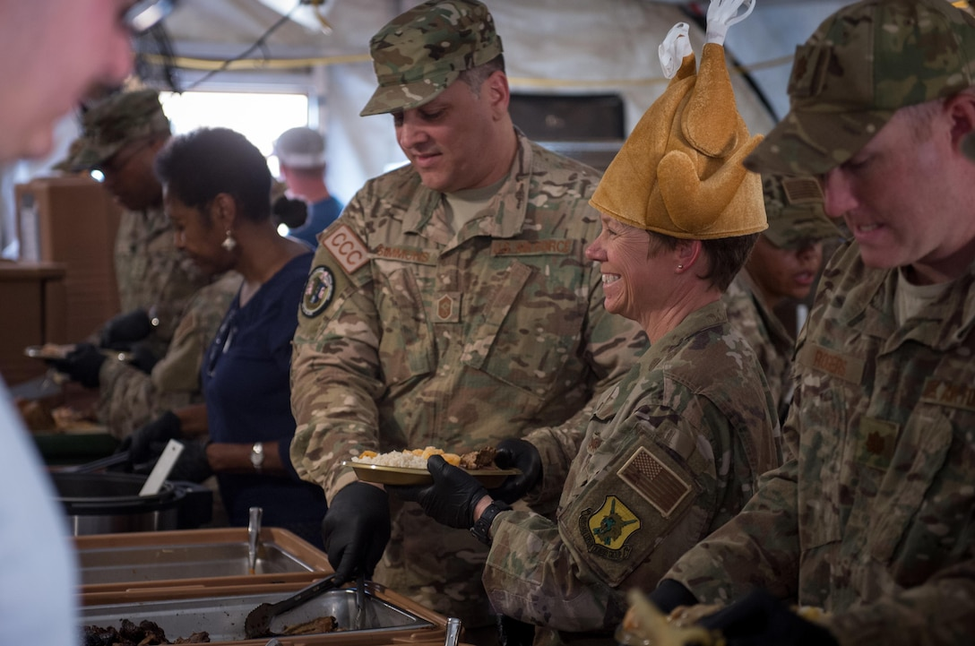 Lt. Col. Marlyce Roth, 724th Expeditionary Air Base Squadron commander, and other Air Force leadership serves Thanksgiving lunch at Air Base 201 in Agadez, Niger, Nov. 24, 2016. During a three day trip, Lt. Gen. Richard Clark, 17th Expeditionary Air Force commander, visited Airmen in Europe and Africa who support the Air Force's intelligence, surveillance and reconnaissance mission. This was Clark's first visit to NAS Sigonella, Niamey and Agadez as 3rd Air Force commander. (U.S. Air Force photo by Tech. Sgt. Ryan Crane)