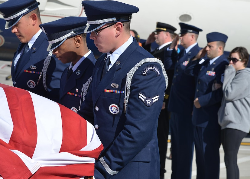 Kirtland Air Force Base Honor Guard members act as pallbearers for Tech. Sgt. Nicholas Heck on Nov. 18 as his remains arrive at the Albuquerque International Sunport en route to Cannon Air Force Base for the funeral. This dignified arrival, the primary mission of honor guards, was the first