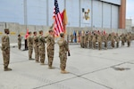BAGRAM AIRFIELD, AFGHANISTAN (Nov. 29, 2016) - Leaders, Soldiers, and guests render honors to the flag during the playing of the national anthem at the transfer of authority ceremony between the 63rd Ordnance Battalion (Explosive Ordnance Disposal) and the 184th Ord. Bn. (EOD).  Photo by Bob Harrison, U.S. Forces Afghanistan Public Affairs.