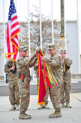 BAGRAM AIRFIELD, AFGHANISTAN (Nov. 29, 2016) - U.S. Army Lt. Col. Edward 'Keith' Rowsey and Command Sgt. Maj. Matthew R. Boehme case the colors of the 63th Ordnance Battalion (Explosive Ordnance Disposal) in preparation for their redeployment to Fort Drum, N.Y.  The 63rd EOD transferred its Task Force EOD mission to the 184th EOD Bn. in a ceremony held here today.  Photo by Bob Harrison, U.S. Forces Afghanistan Public Affairs.