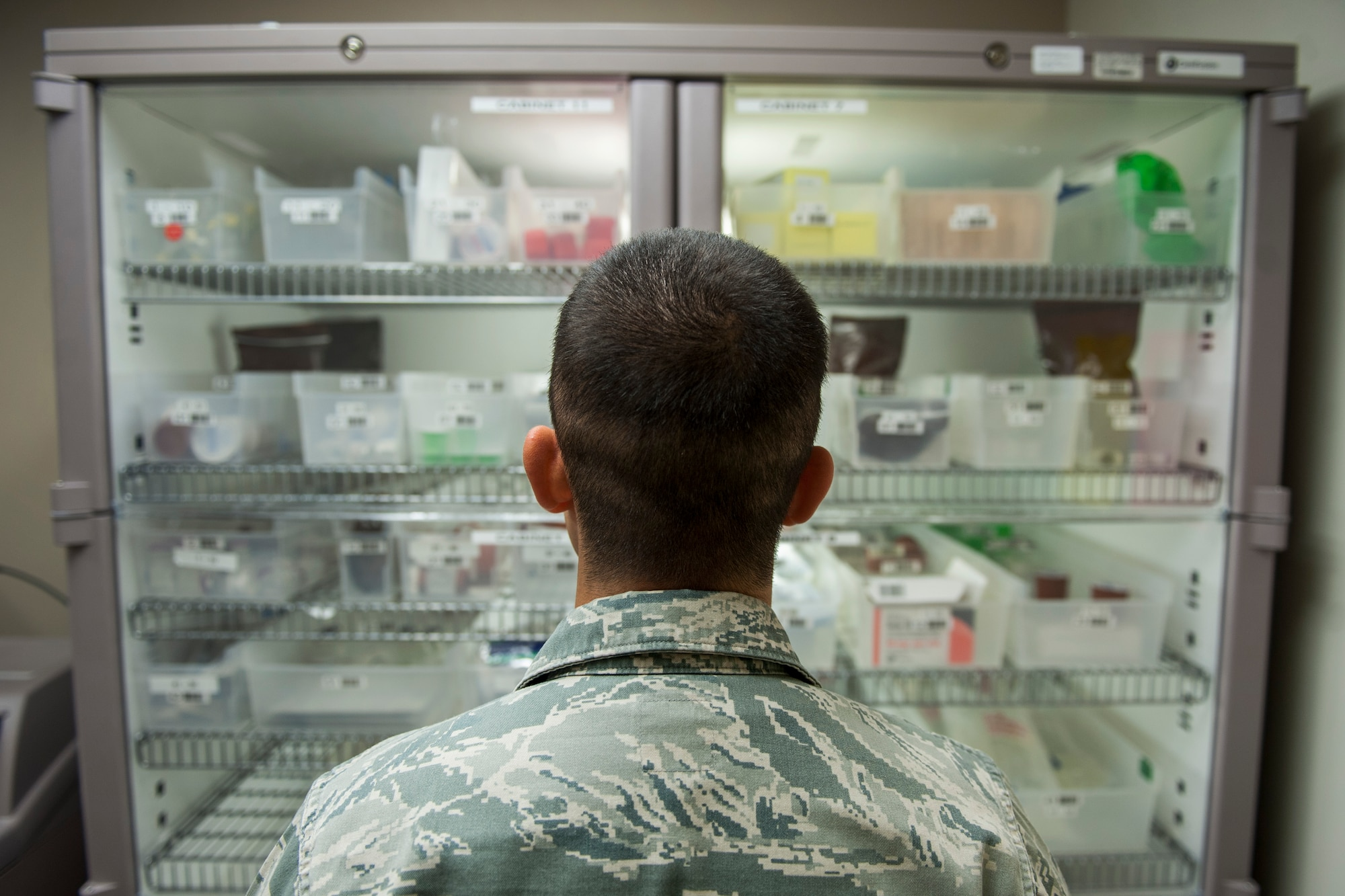 Staff Sgt. Victor Rodriguez, 99th Medical Support Squadron pharmacy technician, refills the Pyxis machine in the intensive care unit of the Mike O'Callaghan Federal Medical Center on Nellis Air Force Base, Nev., Nov. 22, 2016. With the Pyxis machine being utilized, the pharmacy has seen its inaccuracy rates fall. (U.S. Air Force photo by Airman 1st Class Kevin Tanenbaum/Released)