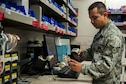 Staff Sgt. Victor Rodriguez, 99th Medical Support Squadron pharmacy technician, scans a medication into the Pyxis database at the Mike O'Callaghan Federal Medical Center on Nellis Air Force Base, Nev., Nov. 22, 2016. 18 new Pyxis machines were implemented throughout the wards of the MOFMC in March, and with these new machine the pharmacy changed the way that each medication was utilized in the system. (U.S. Air Force photo by Airman 1st Class Kevin Tanenbaum/Released)