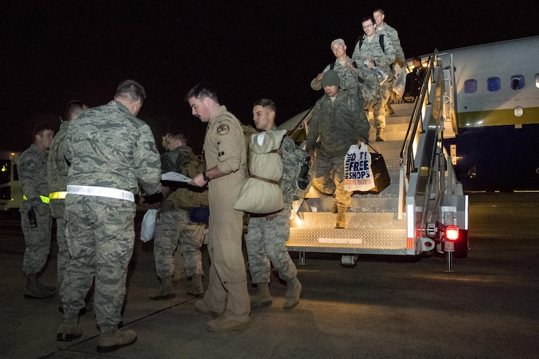Airmen from the 4th Maintenance Group and 335th Fighter Squadron return from a deployment to an undisclosed location in Southwest Asia, Nov. 23, 2016, at Seymour Johnson Air Force Base, North Carolina. More than 80 members returned just in time for the holidays with the bulk of the deployers having returned a month prior. (U.S. Air Force photo by Airman Shawna L. Keyes)