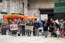 More than 160 friends, family members and coworkers wait to greet about 80 Airmen returning from a deployment supporting OPERATION INHERENT RESOLVE, Nov. 23, 2016, at Seymour Johnson Air Force Base, North Carolina. The Airmen worked 24/7 to conduct operations that directly aided in the Department of Defense's efforts to destroy and degrade the Islamic State of Iraq and Levant. (U.S. Air Force photo by Airman Shawna L. Keyes)