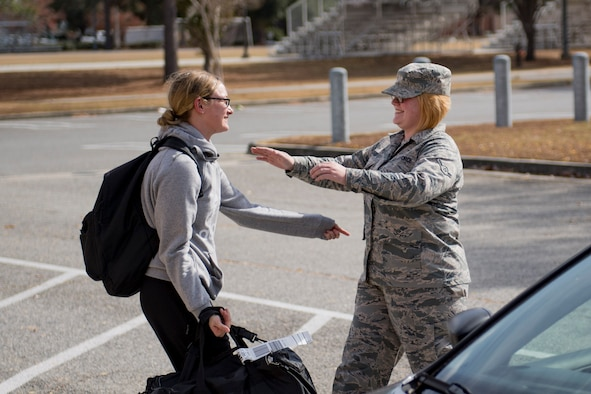 Airman Elizabeth Davis, right, 23d Communications Squadron knowledge management technician, reaches to embrace her sister, Airman 1st Class Ashley Moody, 23d CS client systems technician, Nov. 30, 2016, at Moody Air Force Base, Ga. This was the first time the sisters have seen each other since February, and only the fifth time in eight years. (U.S. Air Force photo by Airman 1st Class Daniel Snider)