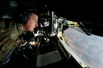 Air Force Senior Airman Kix Payne, a 340th Expeditionary Air Refueling Squadron boom operator, prepares for a Marine EA-6B Prowler to refuel over Iraq, Nov. 29, 2016. The 340th EARS extend the fight against the Islamic State of Iraq and the Levant by delivering 60,000 pounds of fuel to Air Force A-10 Thunderbolts, F-15 Strike Eagles and Marine Corps EA-6B Prowlers. Air Force photo by Senior Airman Jordan Castelan