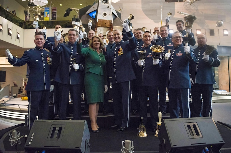 Secretary of the Air Force Deborah Lee James poses for a photo with members of the U.S. Air Force band after participating in a flash mob at the Smithsonian National Air and Space Museum in Washington D.C., with other members of the U.S. Air Force Band and their sister unit the U.S. Air Force Honor Guard, in order to kick off the holiday season by surprising visitors at the Smithsonian's National Air and Space Museum with a flash mob experience Nov. 29, 2016  (U.S. Air Force photo by Senior Master Sgt. Adrian Cadiz)(Released)
